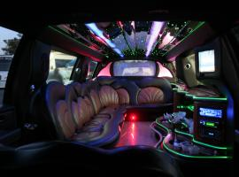 Make yourself comfortable in sumptuous limo with strippers