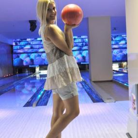 Stag girl attracted in playing bowling