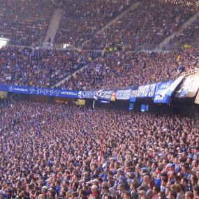 Cheering fans of Hamburg football stadium
